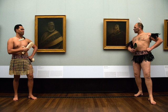 "Members of the cultural group ""Ngati Ranana Maori"" from London perfom in the Alte Nationalgalerie in Berlin, Germany, November 18, 2014. Portraits are on display for the first time outside of New Zealand in the exhibition 'Gottfried Lindauer: The Maori Portraits' which runs from November 20, 2014 until April 12, 2015. (Photo by Matthias Balk/EPA)"