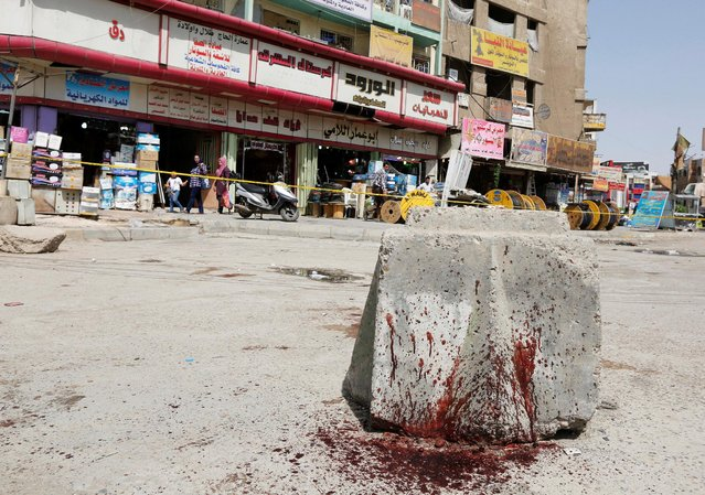 Blood stains are seen at the site of a suicide bomb blast in Baghdad al-Jadida, Iraq September 27, 2016. (Photo by Ahmed Saad/Reuters)