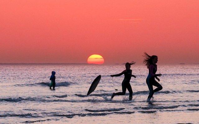 People enjoying the hot weather on Bracklesham Bay in West Sussex, United Kingdom on September 21, 2020. (Photo by Coastal J.J./Bav Media)