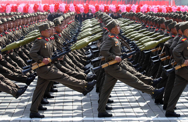 Soldiers march past the podium during a military parade to celebrate the centenary of the birth of Kim Il Sung in Pyongyang, on April 15, 2012. (Photo by Reuters/Stringer)