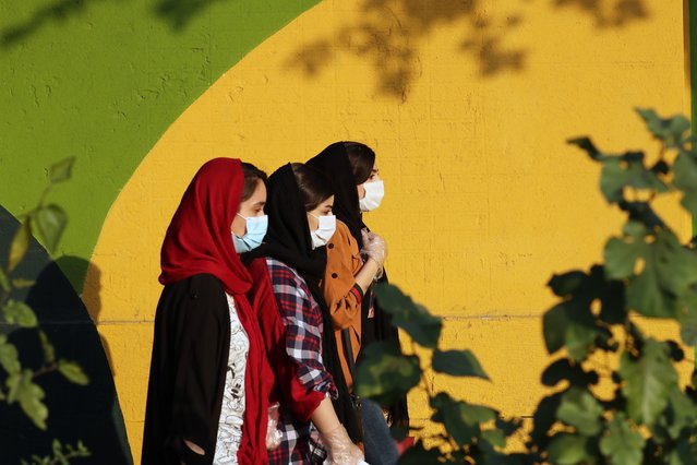 Iranian girls wearing face masks walk in Tehran, Iran, 02 November 2020. According to the Iranian Health ministry, Iran reported its highest daily COVID-19 death toll and infections by announcing 440 deaths and 8,289 new infections in past 24 hours in what appears to be a third wave of COVID-19 outbreak. (Photo by Abedin Taherkenareh/EPA/EFE)