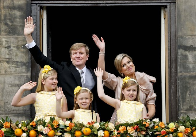 Dutch King Willem-Alexander and Queen Maxima appear on the balcony of the Royal Palace with their children in Amsterdam, The Netherlands, on April 30, 2013. (Photo by Daniel Ochoa de Olza/Associated Press)