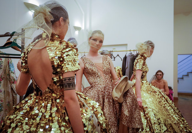 Models get ready for a show backstage during Kazakhstan Fashion Week in Almaty, Kazakhstan April 11, 2018. (Photo by Shamil Zhumatov/Reuters)