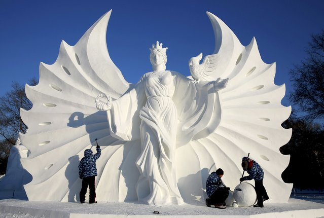 Workers polish a snow sculpture ahead of the 16th Harbin Ice and Snow World in Harbin, Heilongjiang province, December 22, 2014. The 16th Harbin Ice and Snow World will be officially opened on January 5, 2015. (Photo by Reuters/Stringer)