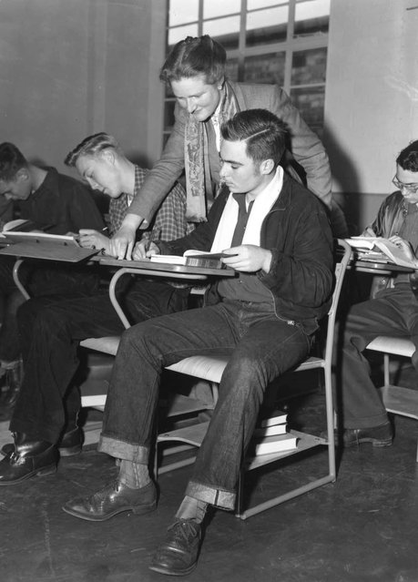 Teacher Alison Falconer supervises a class of boys in the new American-style co-educational school in Bushey Park, Twickenham, Middlesex. It provides boarding accommodation and education for the children of American servicemen living in England, and includes a baseball pitch amongst its facilities. 10th October 1952. (Photo by Ron Case/Keystone/Getty Images)