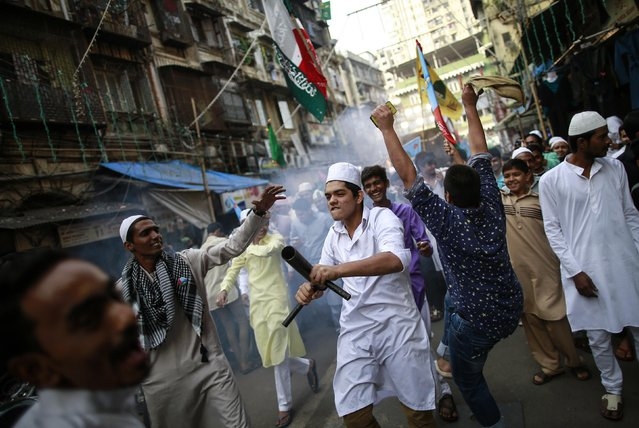 People dance as they celebrate during a procession to mark Eid-e-Milad-ul-Nabi, or birthday celebrations of Prophet Mohammad, in Mumbai January 4, 2015. (Photo by Danish Siddiqui/Reuters)