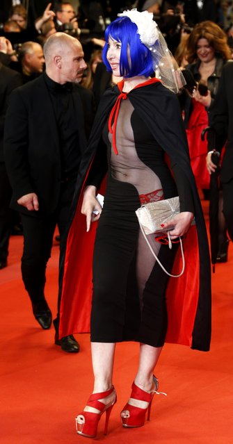 """A guest attends the screening of """"The House That Jack Built"""" during the 71st annual Cannes Film Festival at Palais des Festivals on May 14, 2018 in Cannes, France. (Photo by Regis Duvignau/Reuters)"""