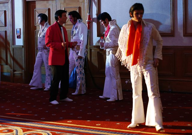 Finalists wait backstage before their performances during the annual European Elvis Tribute Artist Contest and Convention in Birmingham, central England January 4, 2015. (Photo by Darren Staples/Reuters)