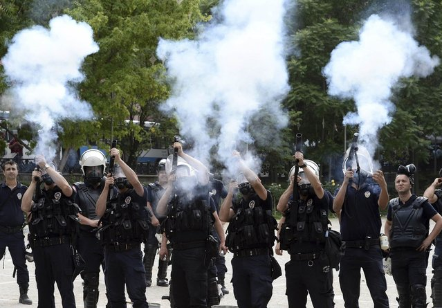 Riot police fire tear gas during a protest against Turkey's Prime Minister Tayyip Erdogan and his ruling AK Party in central Ankara June 2, 2013. (Photo by Reuters/Stringer)