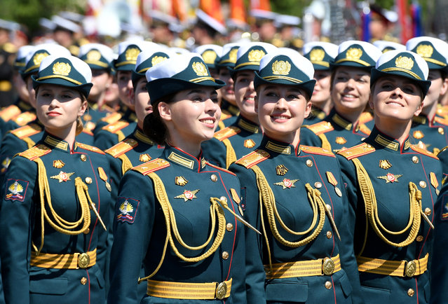 Russian servicewomen march during the Victory Day Parade in Red Square in Moscow, Russia, June 24, 2020. The military parade, marking the 75th anniversary of the victory over Nazi Germany in World War Two, was scheduled for May 9 but postponed due to the outbreak of the coronavirus disease (COVID-19). (Photo by Sergey Pyatakov/Host Photo Agency/AFP Photo)