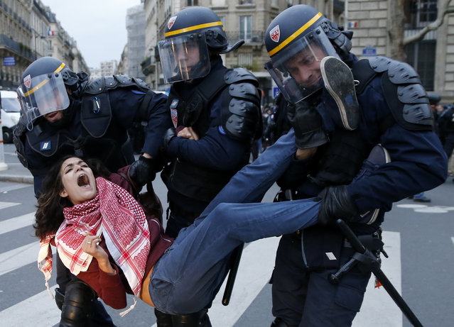 A Woman is arrested by riot police after clashes as they participate in a demonstration at Republique Square on the eve of the COP21 Conference opening, Paris, France, Sunday, November 29, 2015. The 21st Conference of the Parties (COP21) due to be held in Paris from 30 November to 11 December will proceed as planned, despite the terrorist attacks of 13 November. (Photo by Guillaume Horcajuelo/EPA)