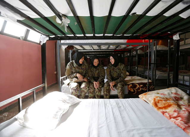 Female soldiers Zarmina Ahmadi, 22 (L), Adela Haidari, 23 (C), and Sabera, 21 (R), from the Afghan National Army (ANA) rest in their barracks at the Kabul Military Training Centre (KMTC) in Kabul, Afghanistan October 26, 2016. (Photo by Mohammad Ismail/Reuters)