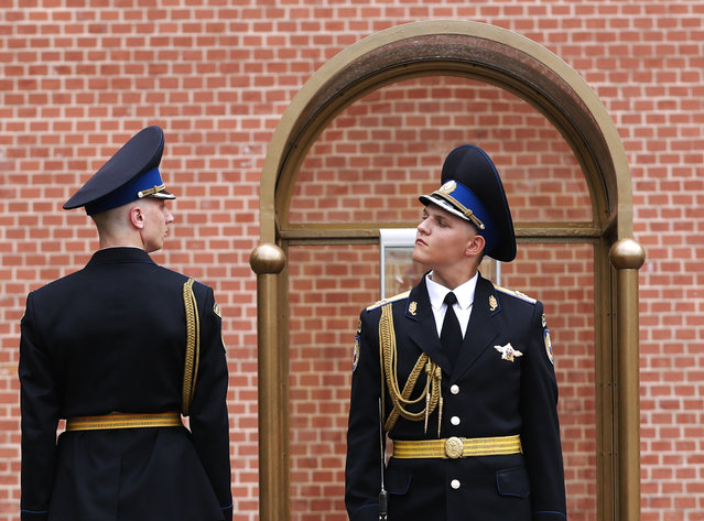 Russian Kremlin honor guards during a change of guards outside the Kremlin walls, Moscow, Russia, 12 June 2018. The FIFA World Cup 2018 will take place in Russia from 14 June to 15 July 2018. (Photo by Rungroj Yongrit/EPA/EFE)