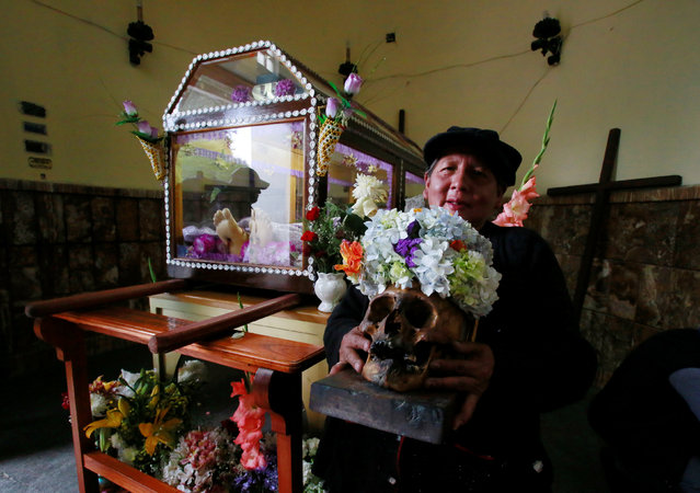 A woman waits for a mass during the Day of Skulls in La Paz, Bolivia, November 8, 2016. (Photo by David Mercado/Reuters)