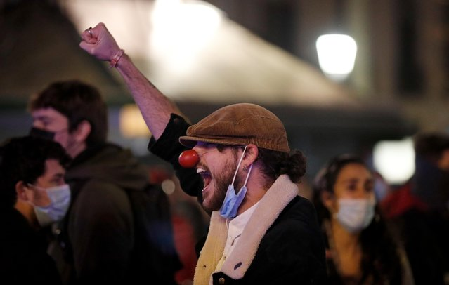 A man gestures and shouts during a protest in support of Catalan rapper Pablo Hasel, after he was given a jail sentence on charges of glorifying terrorism and insulting royalty in his songs, in Barcelona, Spain, February 19, 2021. (Photo by Albert Gea/Reuters)