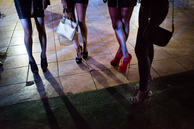 At 3 in the morning, patrons were rushed out the door. Four women with high heels gather with their purses. Popular salsa musicians Alexander Abreu Y Habana d' Primera play at La Cecilia on April 5, 2015 in Havana, Cuba. La Cecilia is a government owned music venue that features a large outdoor area. (Photo by Sarah L. Voisin/The Washington Post)
