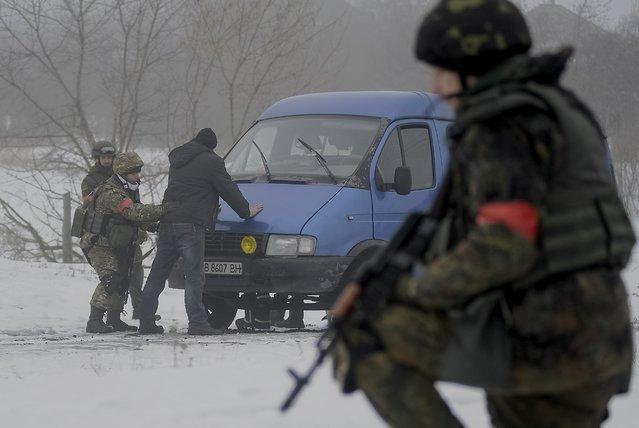 Ukrainian servicemen patrol Orekhovo village in Luhansk region January 28, 2015. (Photo by Maksim Levin/Reuters)