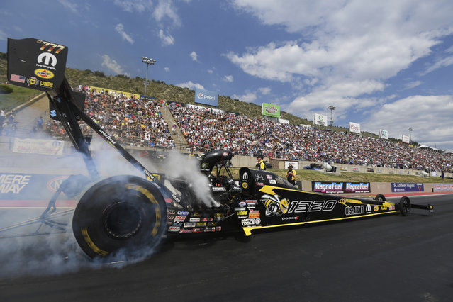 In this photo provided by the NHRA, Leah Pritchett powers to the Top Fuel victory at the annual Dodge Mile-High NHRA Nationals at Bandimere Speedway in Denver, Sunday, July 22, 2018. (Photo by Teresa Long/NHRA via AP Photo)
