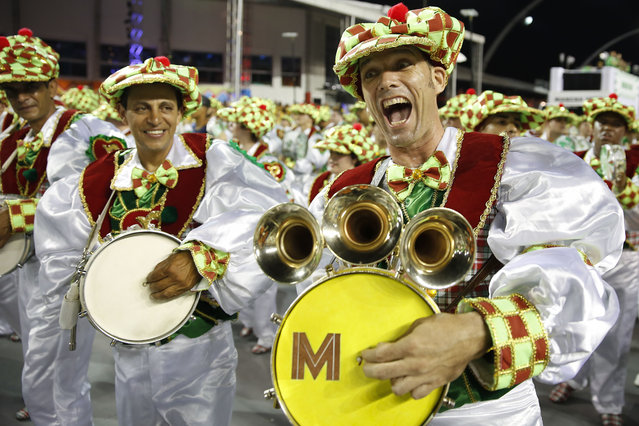 Drummers from the Mancha Verde samba school perform during the Carnival parade at the Sambodromo in Sao Paulo, Brazil, Friday, February 13, 2015. (Photo by Andre Penner/AP Photo)