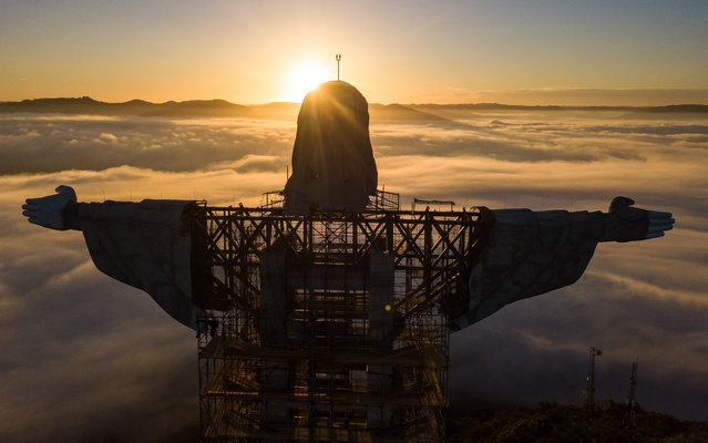 Aerial view of Christ The Protector Statue at sunrise on April 21, 2021 in Encantado, Brazil. The statue under construction in Encantado, Southern Brazil, will be named Cristo the Protector and will surpass the iconic Christ The Redeemer of Rio de Janeiro by five meters. Made of steel and concrete, it will stand 43 meters including its pedestal, and become the third-tallest statue of Jesus Christ in the world. (Photo by Buda Mendes/Getty Images)