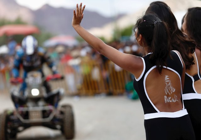 A woman with the Dakar Rally logo painted on her back cheers a quad rider during the seventh stage in the Dakar Rally 2016 in Tupiza, Bolivia, January 9, 2016. (Photo by Marcos Brindicci/Reuters)