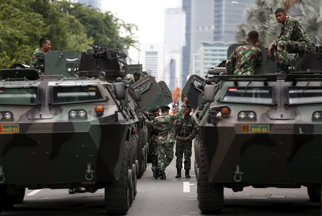 Military armoured personnel carriers are seen near the site of an attack in central Jakarta January 14, 2016. (Photo by Darren Whiteside/Reuters)
