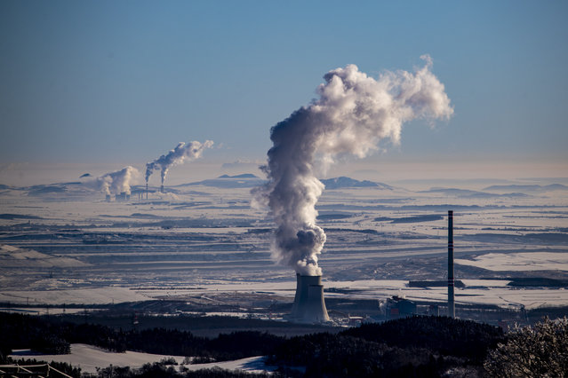 Steam escape from the chimneys of the coal-fired power plant in Prunerov, pictured from village of Vysluni, Czech Republic, 14 February 2021. (Photo by Martin Divisek/EPA/EFE)