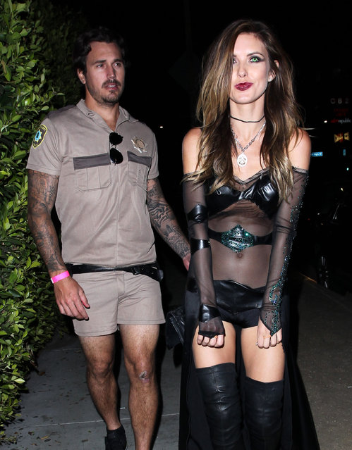 "Former ""The Hills"" star Audrina Patridge and her on again, off again boyfriend Corey Bohan get into a huge fight after attending Matthew Morrison's Halloween Party at Hyde Nightclub in West Hollywood, California on October 25, 2014. Audrina and Corey, who recently split up this past summer, seemed to be in great spirits before the party started but afterwards it was a whole different story! The not so happy couple argued on a bench and at one point a visibly upset Audrina sat on the sidewalk crying! (Photo by FameFlynet)"
