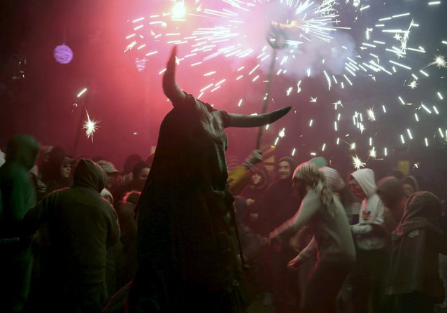 "A reveller dressed as a devil dances among fireworks during traditional ""Correfocs"" (fire runs) to mark the end of the local festivities in Palma, on the Spain's Balearic Island of Mallorca,  January 23, 2016. (Photo by Enrique Calvo/Reuters)"