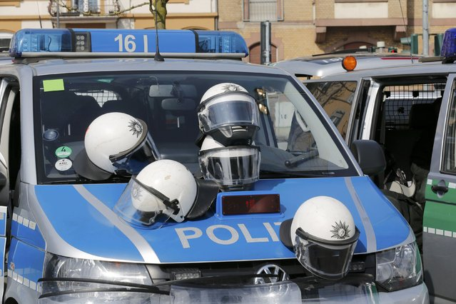 Helmets belonging to riot police officers lie on a police vehicle near to the European Central Bank (ECB) building during the inauguration of it's new headquarters in Frankfurt March 18, 2015. (Photo by Wolfgang Rattay/Reuters)