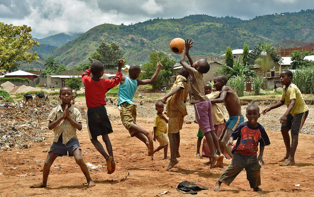 Children play football in Bujumbura, Burundi on March 19, 2015. (Photo by Carl de Souza/AFP Photo)