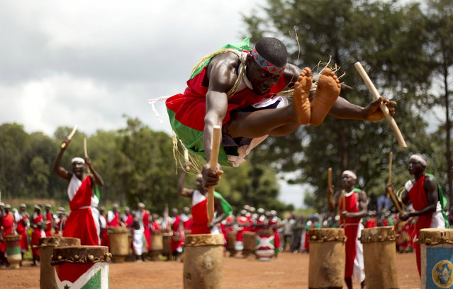 BURUNDI: An artist jumps as traditional drummers perform the royal drum dance during the UNESCO organized drum festival in Gitega, near Burundian capital Bujumbura, April 22, 2016. (Photo by Evrard Ngendakumana/Reuters)