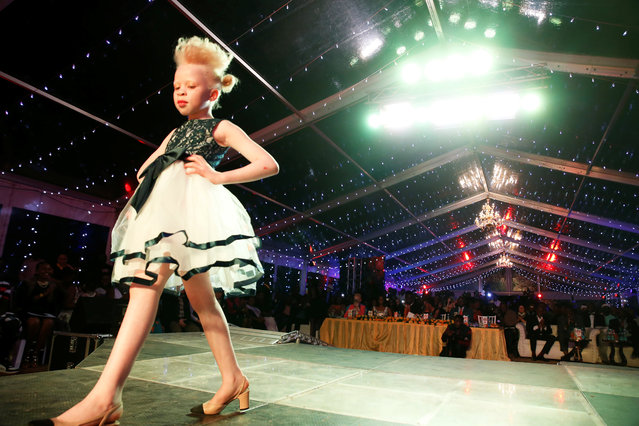 Rebecca Zawadi, 8, performs on the catwalk during the Mr & Miss Albinism Kenya Beauty Pageant 2018 in Nairobi, Kenya, November 30, 2018. (Photo by Baz Ratner/Reuters)