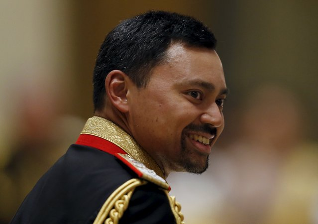 Brunei's Crown Prince smiles during the wedding banquet of newly wed royal couple, Prince Abdul Malik and Dayangku Raabi'atul 'Adawiyyah Pengiran Haji Bolkiah, at the Nurul Iman Palace in Bandar Seri Begawan April 12, 2015. (Photo by Olivia Harris/Reuters)