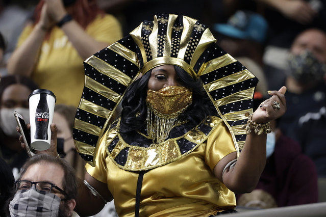 A New Orleans Saints fan parties in the stands in the first half of an NFL preseason football game against the Jacksonville Jaguars in New Orleans, Monday, August 23, 2021. Last season the team played with a marginal number of fans in a largely empty Superdome due to the coronavirus pandemic, but this year fans are allowed with proof of vaccination. (Photo by Derick Hingle/AP Photo)