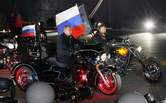 In this file photo taken on Monday, August  29, 2011, then Russian Prime Minister Vladimir Putin rides three wheeler at centre,  accompanied by the Night Wolves biker group leader Alexander Zaldostanov, right, at Novorossiysk, Russia. Poland's Prime Minister Ewa Kopacz spoke out Wednesday April 15, 2015, against plans by Russian nationalistic Night Wolves biker group to ride through Poland on a journey to Berlin to mark the 70th anniversary of the Soviet victory over Nazi Germany. (Photo by Ivan Sekretarev/AP Photo)