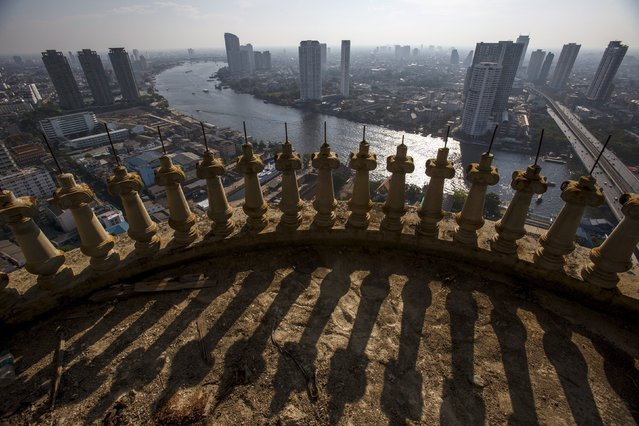 Central Bangkok and the Chao Phraya River are seen from an abandoned skyscraper in Bangkok April 19, 2015. (Photo by Athit Perawongmetha/Reuters)