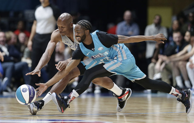 Home team's Famous Los, right, and Away team's Ray Allen chase the ball during the first half of an NBA All-Star Celebrity basketball game in Charlotte, N.C., Friday, February 15, 2019. (Photo by Gerry Broome/AP Photo)