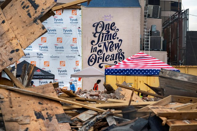 Workers clean up the site of the Historic Karnofsky Shop, a historic, building that collapsed during Hurricane Ida in New Orleans, Louisiana, U.S., September 6, 2021. (Photo by Kathleen Flynn/Reuters)