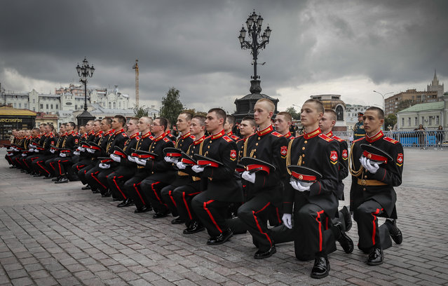 Russian cadets take part in the Solemn ceremony of initiation of freshmen of the Moscow Military Music School into the Suvorovites in front of Cathedral of Christ the Savior in Moscow, Russia, 01 September 2021. The Moscow Military Music School converted from the 2nd Moscow School of Military Musicians of the Red Army, created in 1937. The training period of cadets 3 years 10 months. (Photo by Yuri Kochetkov/EPA/EFE)