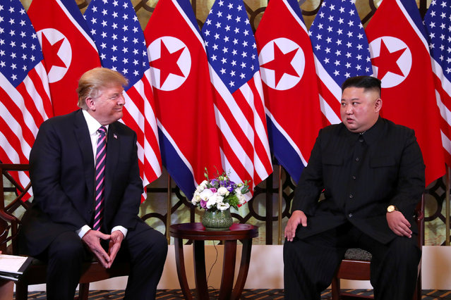 U.S. President Donald Trump and North Korean leader Kim Jong Un sit down before their one-on-one chat during the second U.S.-North Korea summit at the Metropole Hotel in Hanoi, Vietnam February 27, 2019. (Photo by Leah Millis/Reuters)