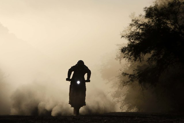 Juan Carlos Salvatierra, from Bolivia, races his Speedbrain motorcycle between the cities of San Miguel de Tucuman and Salta, Argentina on January 10, 2014. (Photo by Victor R. Caivano/Associated Press)