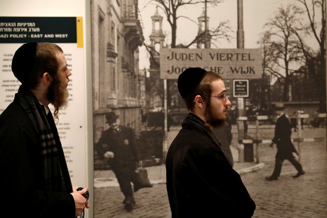 Ultra-Orthodox Jewish visitors stand next to an exhibit during a visit to Yad Vashem's Holocaust History Museum in Jerusalem, January 26, 2017. (Photo by Amir Cohen/Reuters)