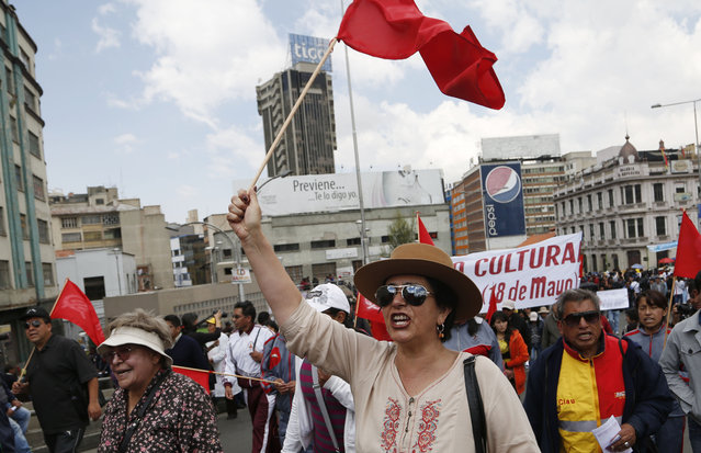 Demonstrators shout slogans as they take part in a May Day march, in La Paz, Bolivia, Friday, May 1, 2015. (Photo by Juan Karita/AP Photo)