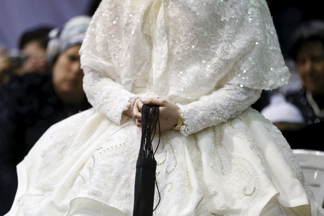 """An ultra-Orthodox Jewish bride takes part in the """"mitzva tantz"""", the custom in which relatives dance in front of the bride after her wedding ceremony, in Netanya, Israel, early March 16, 2016. (Photo by Baz Ratner/Reuters)"""
