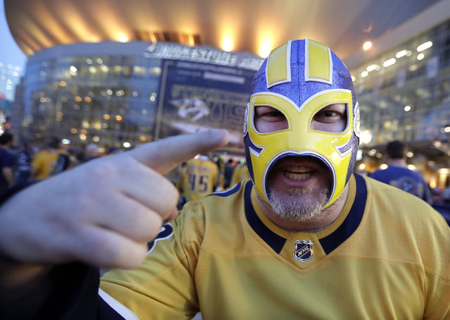 "Scott Barry, who goes by the name of ""The Ultimate Predator"" at hockey games, waits to enter Bridgestone Arena for Game 1 of an NHL hockey first-round playoff series between the Nashville Predators and the Dallas Stars on Wednesday, April 10, 2019, in Nashville, Tenn. (Photo by Mark Humphrey/AP Photo)"