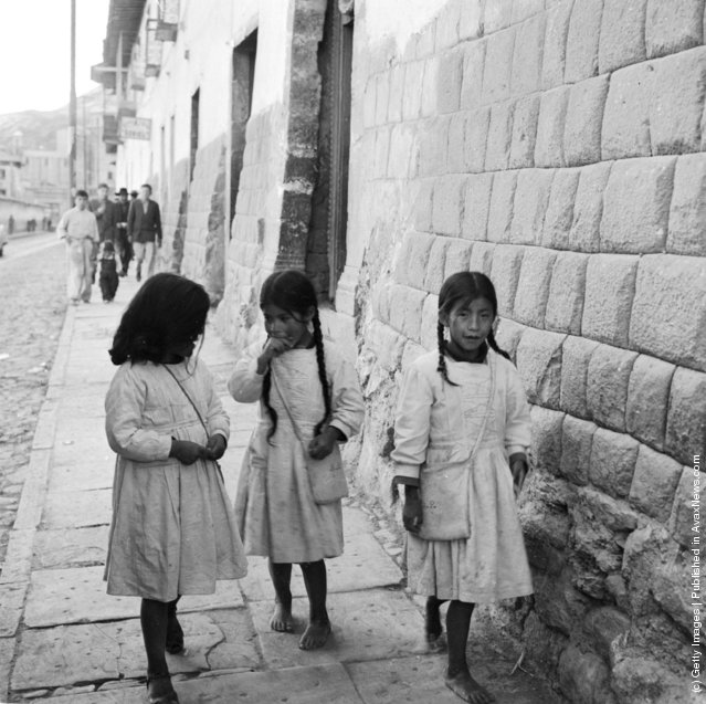 Three young girls in the streets of Cuzco, Peru, 1955