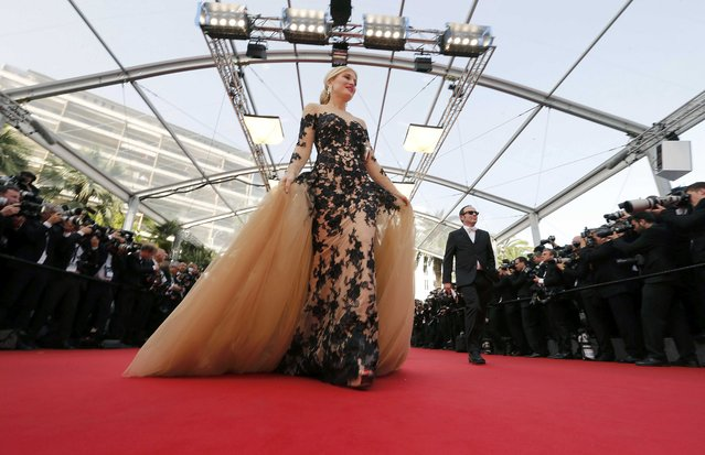 """Actress and model Hofit Golan poses on the red carpet as she arrives for the opening ceremony and the screening of the film """"La tete haute"""" out of competition during the 68th Cannes Film Festival in Cannes, southern France, May 13, 2015. (Photo by Regis Duvignau/Reuters)"""