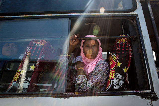 A Rohingya girl sits on a bus as relocated to their new temporary shelter on May 13, 2015 in Lhoksukon, Aceh province, Indonesia. Boats carrying over 500 of Myanmar's Rohingya refugees have arrived in Indonesia, many requiring medical attention. They have warned that thousands more are thought to be still at sea. (Photo by Ulet Ifansasti/Getty Images)