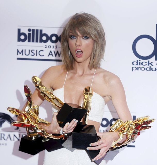"Singer Taylor Swift poses backstage with her awards for Top Artist, Billboard Chart Achievement Award, Top Female Artist, Top Hot 100 Artist, Top Digital Songs Artist, Top Streaming Song (Video) for ""Shake it Off"" and Top Billboard 200 Album for ""1989"" during the 2015 Billboard Music Awards in Las Vegas, Nevada May 17, 2015. (Photo by L. E. Baskow/Reuters)"